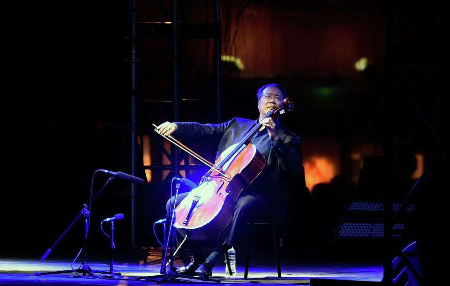 "Chinese-US cellist Yo-Yo Ma performs during a concert called ""The Bach Project"" at the Monumento a la Revolucion in Mexico City on March 26, 2019. - Yo-Yo Ma sets out to perform Johann Sebastian Bach's six suites for solo cello in one sitting, in 36 locations around the world. (Photo by ALFREDO ESTRELLA / AFP)ALFREDO ESTRELLA/AFP/Getty Images Photo: ALFREDO ESTRELLA, Contributor / AFP/Getty Images / AFP or licensors"