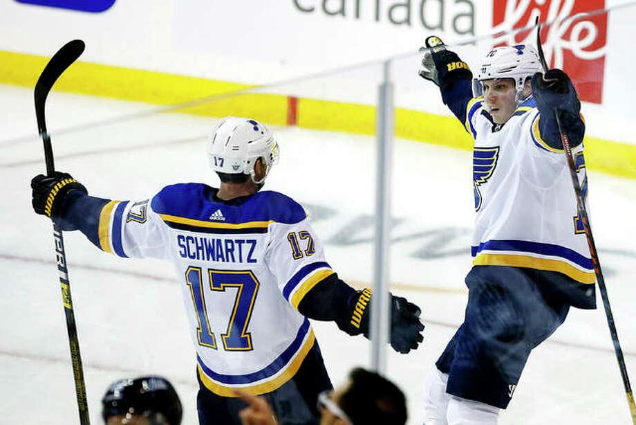 The Blues' Oskar Sundqvist (70) celebrates with teammate Jaden Schwartz (17) after scoring against the Winnipeg Jets Friday night in Winnipeg, Manitoba. Photo: AP Photo