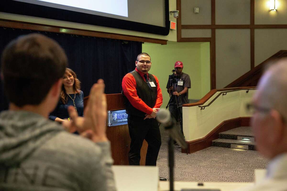 Tristan Martinez, a participant of the Reactor Room, gives his pitch presentation about working in the fitness industry to a panel of community leaders at Rice University on March 21, 2019.