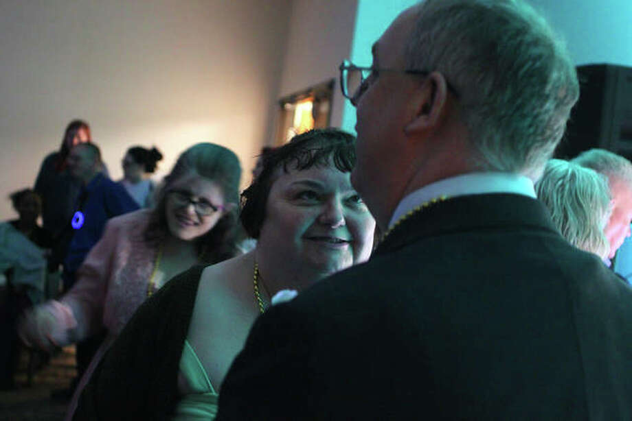 Tammy Allen and Joel Eitemiller dance together at the Pathway Services prom Friday night. Pathway Services hosted the under-the-sea-themed dance for clients and their guests, complete with pictures, a DJ and refreshments. Photo: Rosalind Essig | Journal-Courier