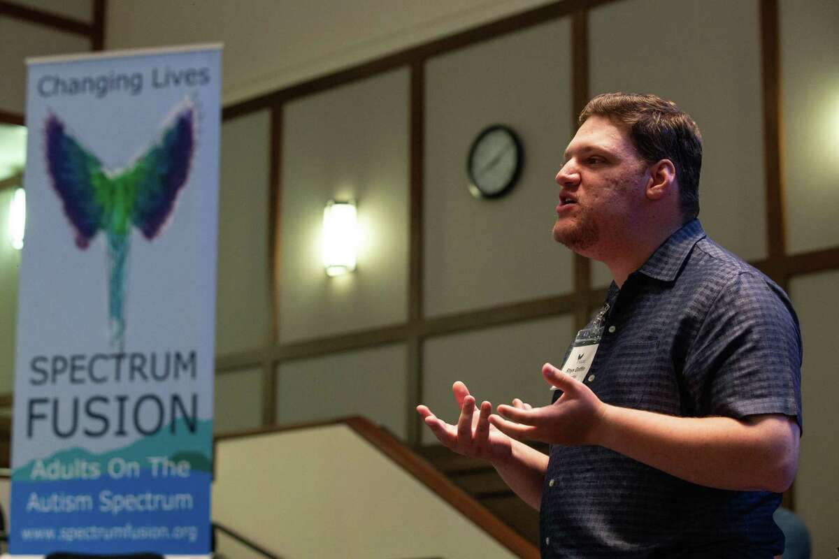 Rhys Griffin, an aspiring media producer, gives his presentation to a panelist of community leaders at the Spectrum Fusion Reactor Room event, a forum that provides opportunities and connections to adults on the autism spectrum.