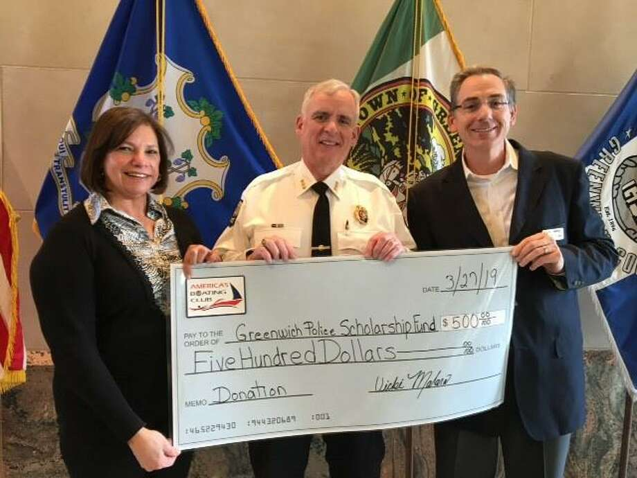 America's Boating Club of Greenwich presents the Greenwich Police Department with a check to benefit the GPD's Scholarship Fund. Vicki Malara, left, and Andy Cummings, right, with Chief of Police James Heavey, whose two children have completed the club's safe boating classes. Photo: Contributed /