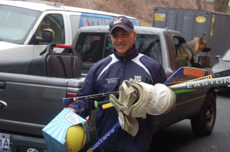 State Rep. Fred Camillo Camillo carries donated sports equipment to the Boys and Girls Club of Greenwich last year. He is leading another drive that will be collecting sports equipment through April 19. Photo: Ken Borsuk /