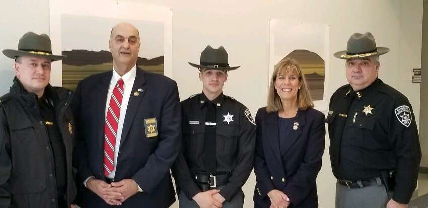 Rensselaer County Deputy Sheriff Kyle Loeper recently graduated from the Zone 14 Training Academy. Joining Deputy Loeper (center) in the photo from left to right areCaptain Derek Pyle, Sheriff Pat Russo,State Senator Daphne Jordan and Undersheriff Ed Bly.