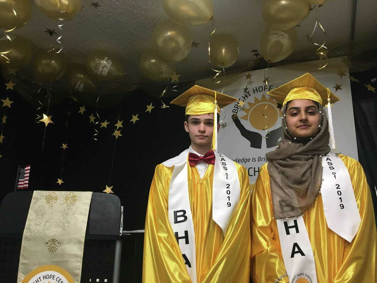 Mohammad Dhailia, 15, and Elham Malik, 14, graduated from Bright Hope Academy Center on Saturday. The duo will attend the College of St. Rose in the fall.