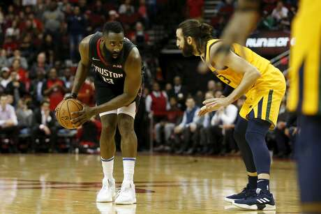 HOUSTON, TX - DECEMBER 17:  James Harden #13 of the Houston Rockets controls the ball defended by Ricky Rubio #3 of the Utah Jazz in the second half at Toyota Center on December 17, 2018 in Houston, Texas. (Photo by Tim Warner/Getty Images)