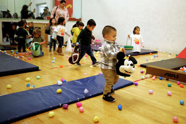 Children participate in an egg hunt during the Egg-stravaganza community event April 13, 2019, at the Midland YMCA. James Durbin / Reporter-Telegram