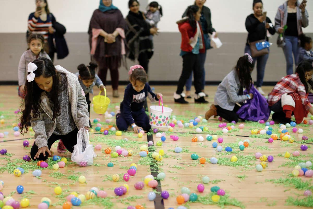 Children hunt for eggs during the Egg-stravaganza community event April 13, 2019, at the Midland YMCA. James Durbin / Reporter-Telegram