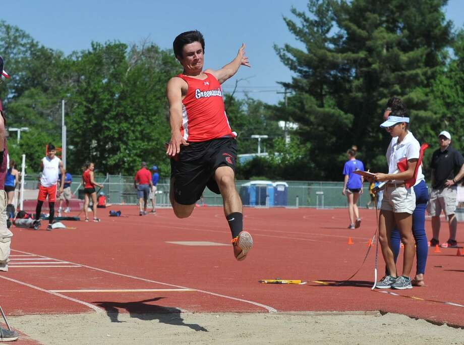 Greenwich's Owen Bianchi competes in the long jump during the Class LL state championship meet on May 30. Photo: Gregory Vasil / For Hearst Connecticut Media / Connecticut Post Freelance