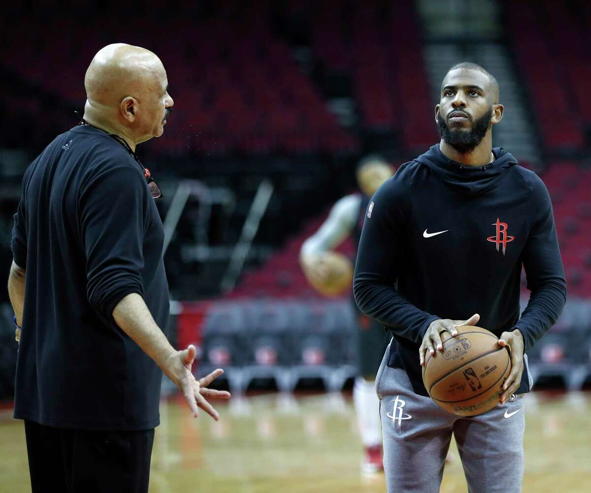 Houston Rockets guard Chris Paul shoots baskets while talking with assistant coach John Lucas during the Houston Rockets practice at Toyota Center,Saturday, April 13, 2019, in Houston, as the Rockets prepare to face the Utah Jazz in a best-of-seven series during the First Round of the 2019 NBA Playoffs.