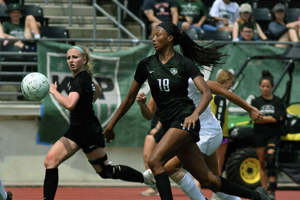 Kingwood Park senior Allie Byrd, center, pushes the ball upfield against the Pflugerville defense during the second half of their Region III-5A Girls Soccer finals matchup at Turner Stadium in Humble on Saturday, April 13, 2019.