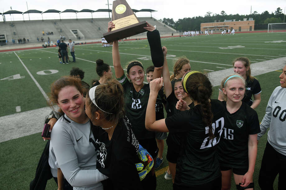 Kingwood Park senior Bailey Schoener (22) hoists her team's trophy after defeating Plflugerville 2-1 in their Region III-5A Girls Soccer finals matchup at Turner Stadium in Humble on Saturday, April 13, 2019. Photo: Jerry Baker, Contributor / Houston Chronicle