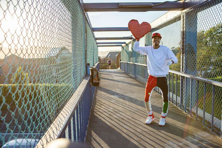 JaVonne Hatfield, who is known as the Heart Guy, performs on the Highway 101 pedestrian bridge near the Vermont Street exit on Wednesday, April 10, 2019, in San Francisco, Calif. Photo: Santiago Mejia / The Chronicle