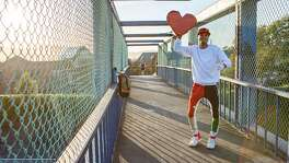 JaVonne Hatfield, who is known as the Heart Guy, performs on the Highway 101 pedestrian bridge near the Vermont Street exit on Wednesday, April 10, 2019, in San Francisco, Calif.
