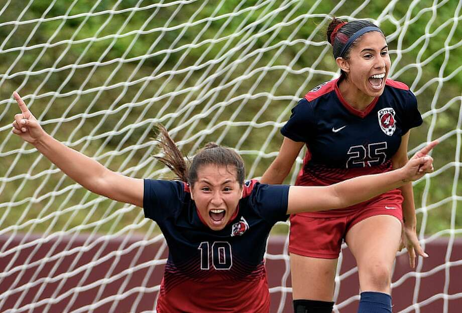 Tompkins forward Barbara Olivieri, left, celebrates her goal with Gabriela Rodriguez during the first half of a 6A region 3 final high school soccer match against Kingwood, Saturday, April 13, 2019, in Deer Park. Photo: Eric Christian Smith/Contributor