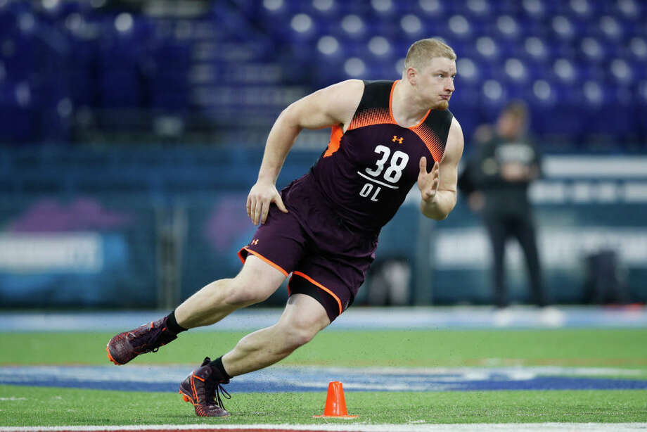 PHOTOS: New Era's official 2019 NFL Draft caps  INDIANAPOLIS, IN - MARCH 01: Offensive lineman Kaleb McGary of Washington in action during day two of the NFL Combine at Lucas Oil Stadium on March 1, 2019 in Indianapolis, Indiana. (Photo by Joe Robbins/Getty Images) >>>See the caps that will be worn by players at the 2019 NFL Draft ...  Photo: Joe Robbins/Getty Images / 2019 Joe Robbins