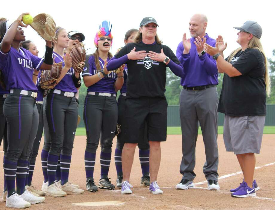 Former Willis softball coach Stephanie Shelly, center, reacts after learning the Ladykats' home field was renamed 'Shelly Field' in her honor before a game against Lake Creek on Friday, April 12, 2019. Photo: Justin Maskulinski / Staff Writer