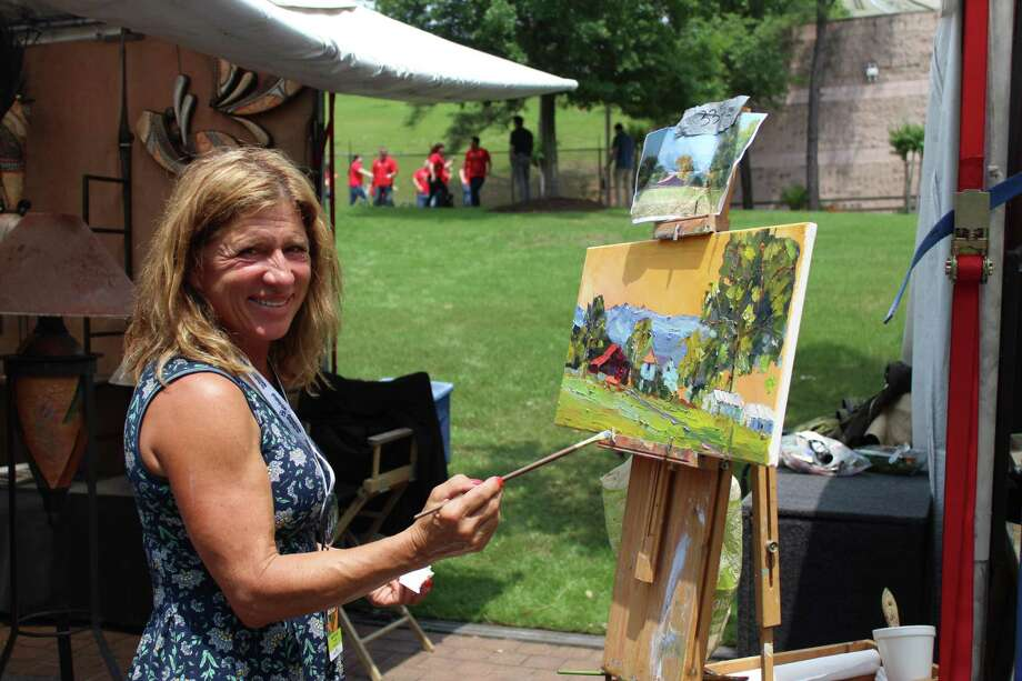 The 2019 The Woodlands Waterway Arts Festival was deemed a rousing success by organizers despite some bad weather on the first day of the event that led to a decrease in two-day attendance. This year, an estimated 11,000 people attended the event, which is about 3,000 less than in prior years, officials confirmed. Photo: Photos By Jeff Forward/The Houston Chronicle / Photos By Jeff Forward/The Houston Chronicle
