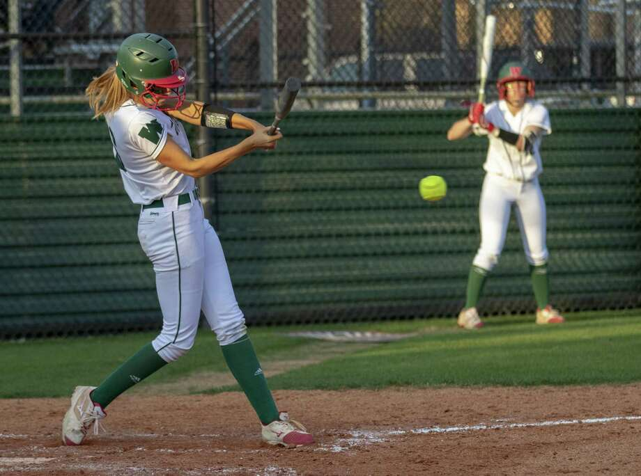 In this file photo, The Woodlands third baseman Skylar Sirdashney (16) hits a ball during a District 15-6A softball game Tuesday, March 19, 2019 at The Woodlands High School. Photo: Cody Bahn, Houston Chronicle / Staff Photographer / © 2018 Houston Chronicle