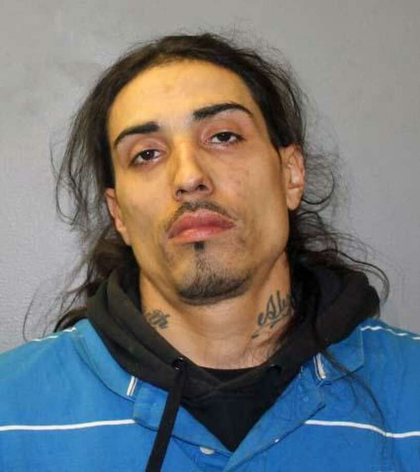 Rafly Santiago, 30, of Cook Avenue in Meriden, Conn., was charged with second-degree burglary, third-degree larceny and third-degree criminal trespass. Photo: Contributed Photo / Hamden Police Department / Contributed Photo / Connecticut Post Contributed