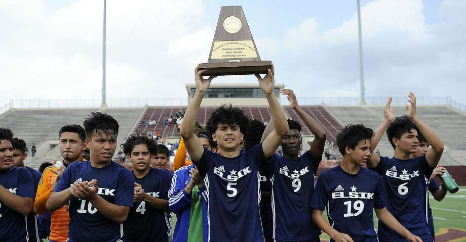 Elsik's Andriel Aguirre (5) and teammates celebrate the team's win over Spring Woods in a 6A region 3 final high school soccer match, Saturday, April 13, 2019, in Deer Park. Photo: Eric Christian Smith/Contributor