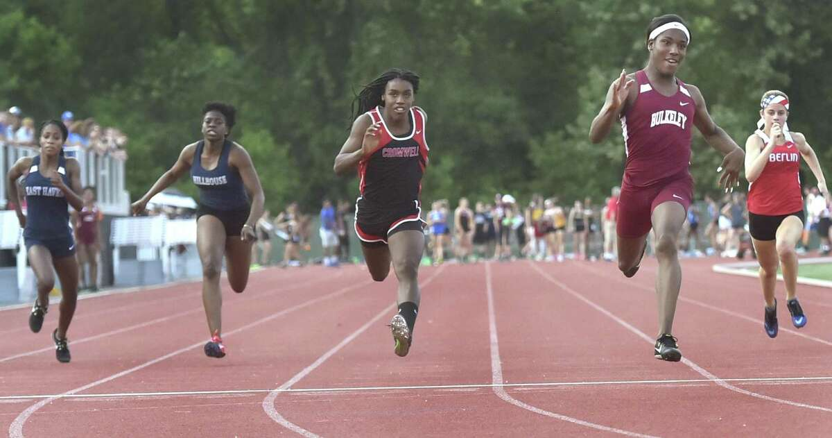 Terry Miller of Bulkeley High School wins the girls 100-meter dash finals, fourth from left, during the CIAC Class M outdoor track and field championships May 29. Cromwell's Andraya Yearwood placed second, third from left, Berlin's Nikkie Xiarhus placed third, fifth from left, Hillhouse's Ayesha Nelson placed fourth and East Haven's Kisha Francois fifth.