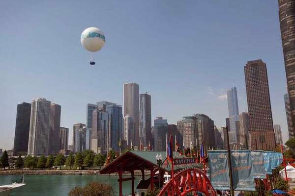 Passengers get an aerial view of the city while riding the AeroBalloon at Navy Pier September.