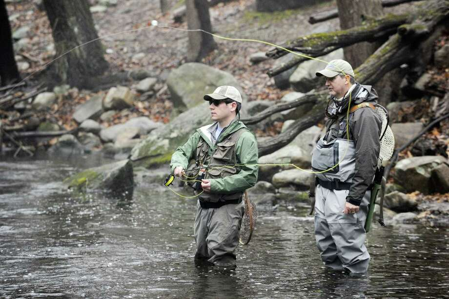 Anglers Rich Saltzman and Pat O'Hara, both of Stamford, fish along the banks of the Mianus River in Stamford on Saturday, the opening day of the trout fishing season. Photo: Matthew Brown / Hearst Connecticut Media / Stamford Advocate
