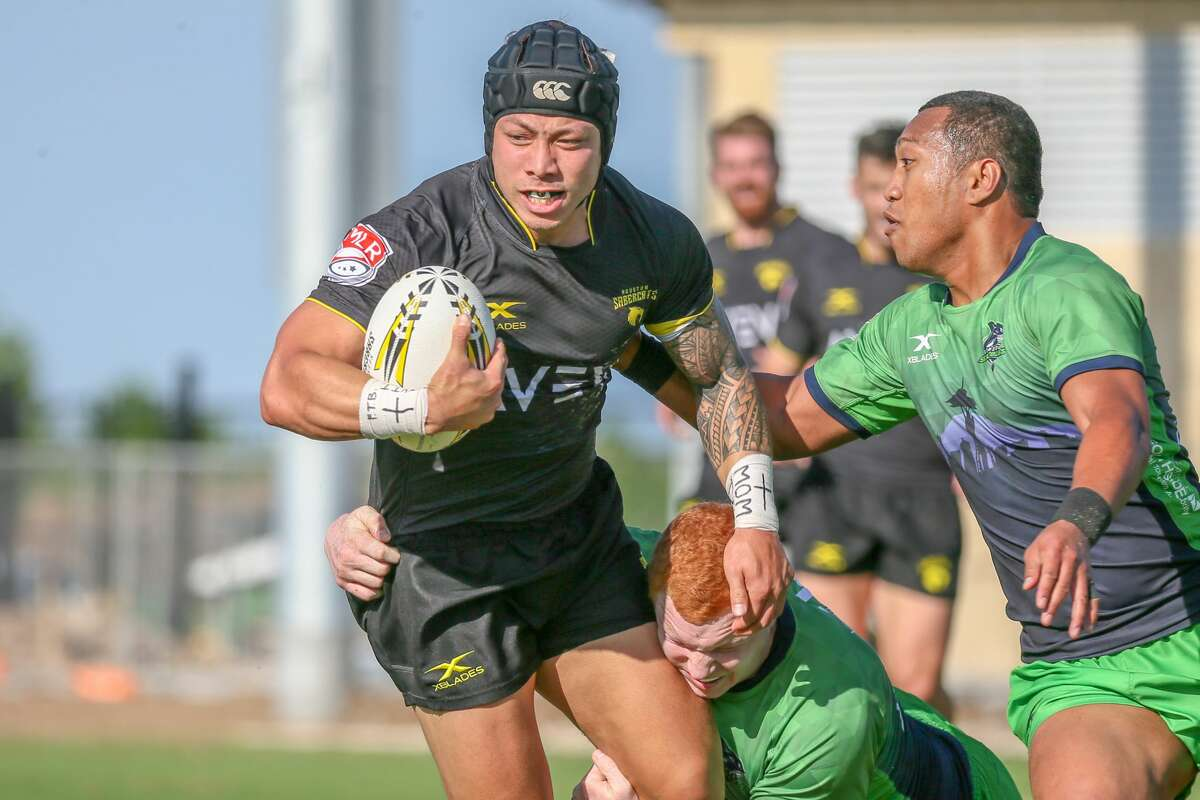 April 13, 2019: Houston SaberCats fullback Kieran Farmer (15) gets tackled during the Major League Rugby match between the Seattle Seawolves and Houston SaberCats at Aveva Stadium in Houston, Texas.