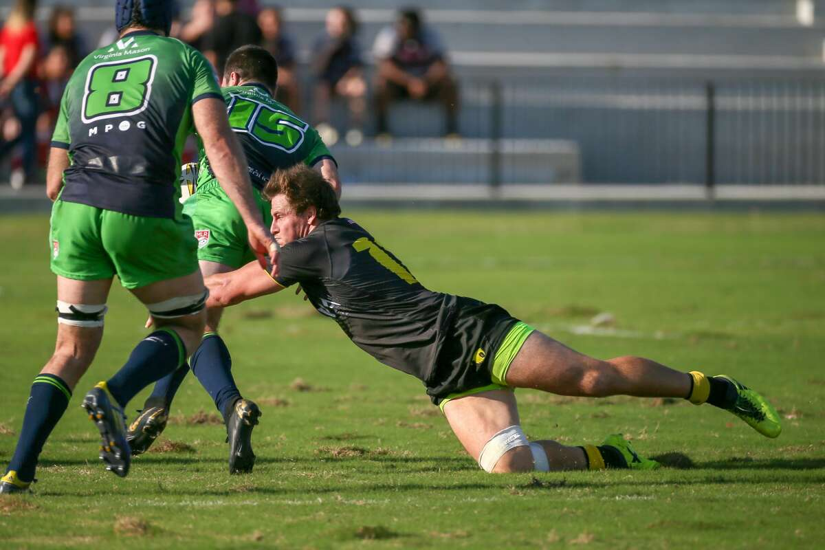 April 13, 2019: Houston SaberCats center Max Tacket (12) tackles Seattle Seawolvesfullback Matthew Turner (15) during the Major League Rugby match between the Seattle Seawolves and Houston SaberCats at Aveva Stadium in Houston, Texas.