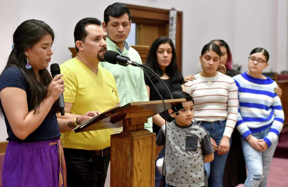 New Haven,  Connecticut - Saturday, April 13, 2019:  Nelson Pinos,  an undocumented immigrant from Ecuador facing deportation and in his 500th day in sanctuary at the First and Summerfield Church in New Haven Saturday, addresses supporters at the opening of a photographic exhibition fundraising event for him and his family Saturday evening at the church.  The photo exhibit documents Pinos, in sanctuary in New Haven since November 30, 2017, and Sujitno Sajuti, in sanctuary in Meriden since October 10. 2017.  Pinos, a resident of New Haven, has lived in the U.S. since 1992. He is married and the father of three American citizen children Photo: Peter Hvizdak, Hearst Connecticut Media / New Haven Register
