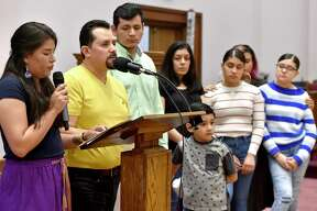 New Haven, Connecticut - Saturday, April 13, 2019: Nelson Pinos, an undocumented immigrant from Ecuador facing deportation and in his 500th day in sanctuary at the First and Summerfield Church in New Haven Saturday, addresses supporters at the opening of a photographic exhibition fundraising event for him and his family Saturday evening at the church. The photo exhibit documents Pinos, in sanctuary in New Haven since November 30, 2017, and Sujitno Sajuti, in sanctuary in Meriden since October 10. 2017. Pinos, a resident of New Haven, has lived in the U.S. since 1992. He is married and the father of three American citizen children