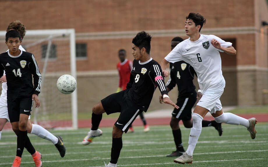 Sharpstown junior Ulises Reyes (8) controls the ball against Kingwood Park junior Robert Henry (6) during the second half of their Region III-5A Boys Soccer finals matchup at Turner Stadium in Humble on Saturday, April 13, 2019. Photo: Jerry Baker/Contributor