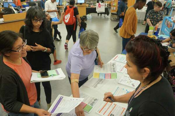 Connie Assiff of?Harris County Public Health (right) displays her organization's services.