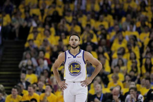 00c4d45be198 1of2Golden State Warriors Stephen Curry is seen during a break in the  action in the first quarter during game 1 of the Western Conference  Playoffs between ...