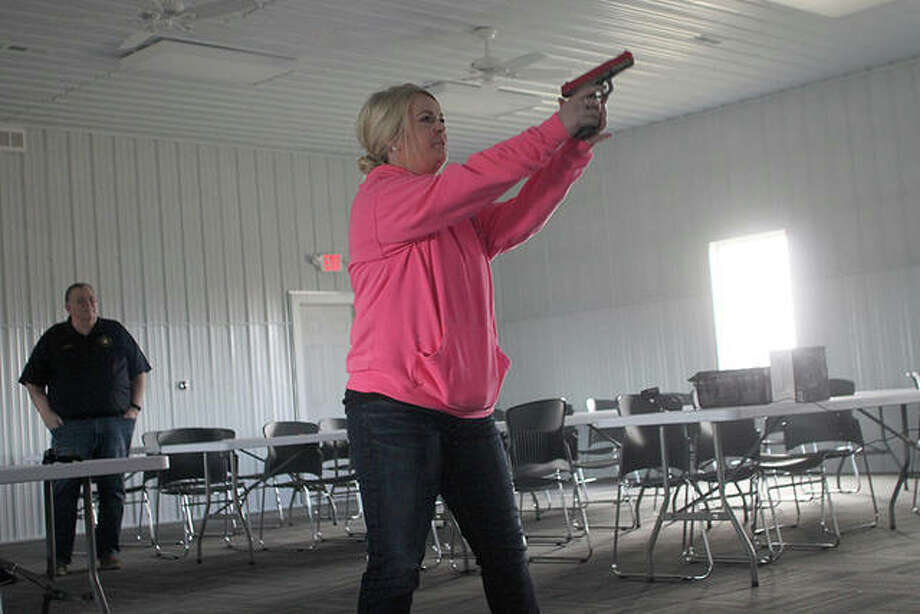 Jacksonville Citizen's Police Academy participants practiced use-of-force scenarios using a simulator Saturday. The simulator is part of the Illinois Fraternal Order of Police's Project Blue Life. Photo: Rosalind Essig | Journal-Courier