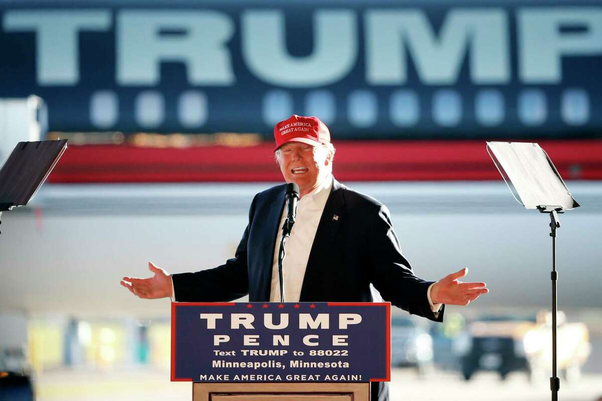 FILE - In this Sunday, Nov. 6, 2016 file photo, Republican presidential candidate Donald Trump addresses the crowd during a campaign stop at the Minneapolis International Airport. On Monday, April 15, 2019, President Trump is travelling to Minnesota, where he lost to Hillary Clinton by fewer than 45,000 votes in 2016, but his re-election campaign is also targeting New Mexico, Nevada, and New Hampshire _ all states where he trailed by under 100,000 votes. (AP Photo/Charles Rex Arbogast)