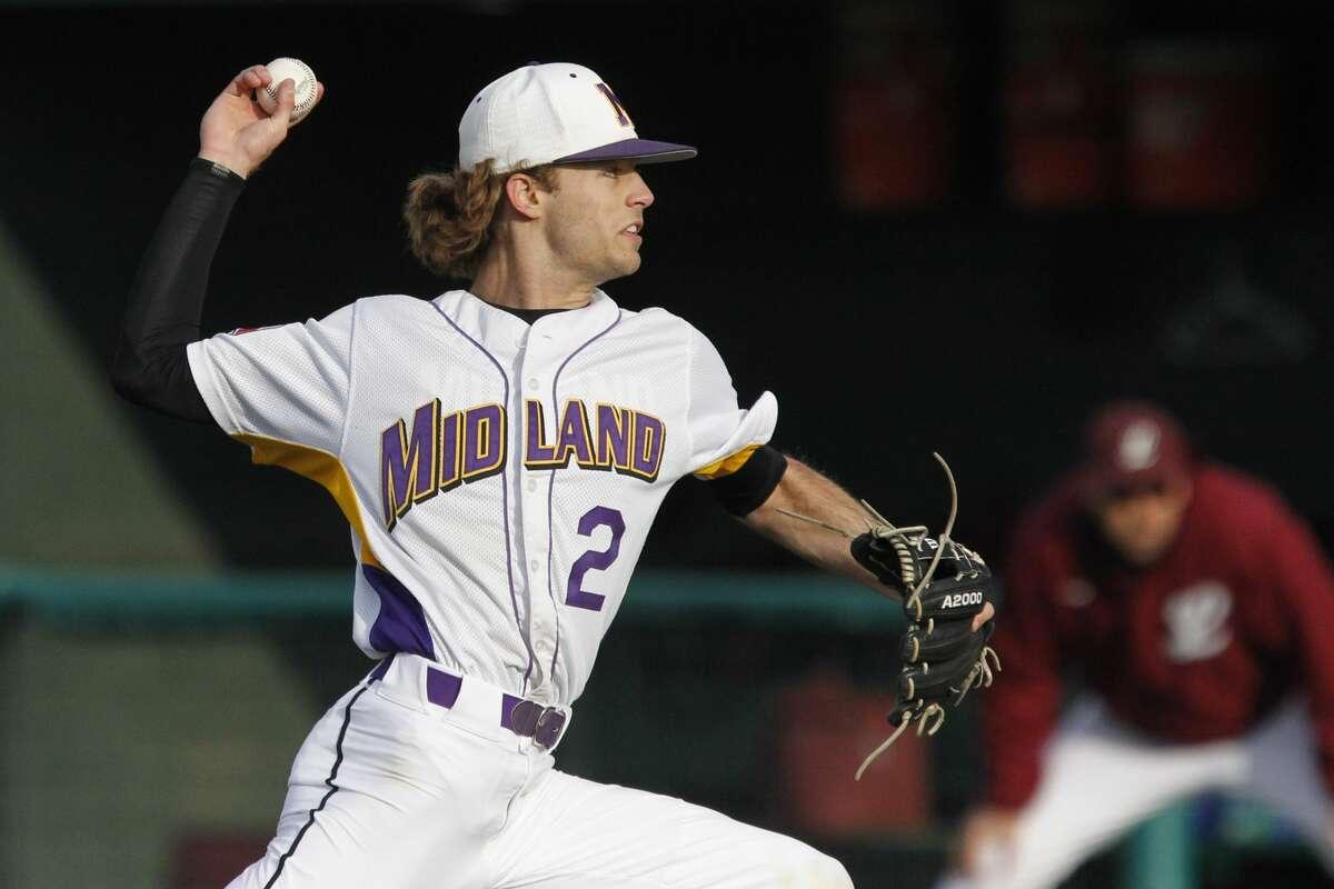 Midland High's Tyler Wade (2) pitches against Lee April 13, 2019, at Christensen Stadium. James Durbin / Reporter-Telegram