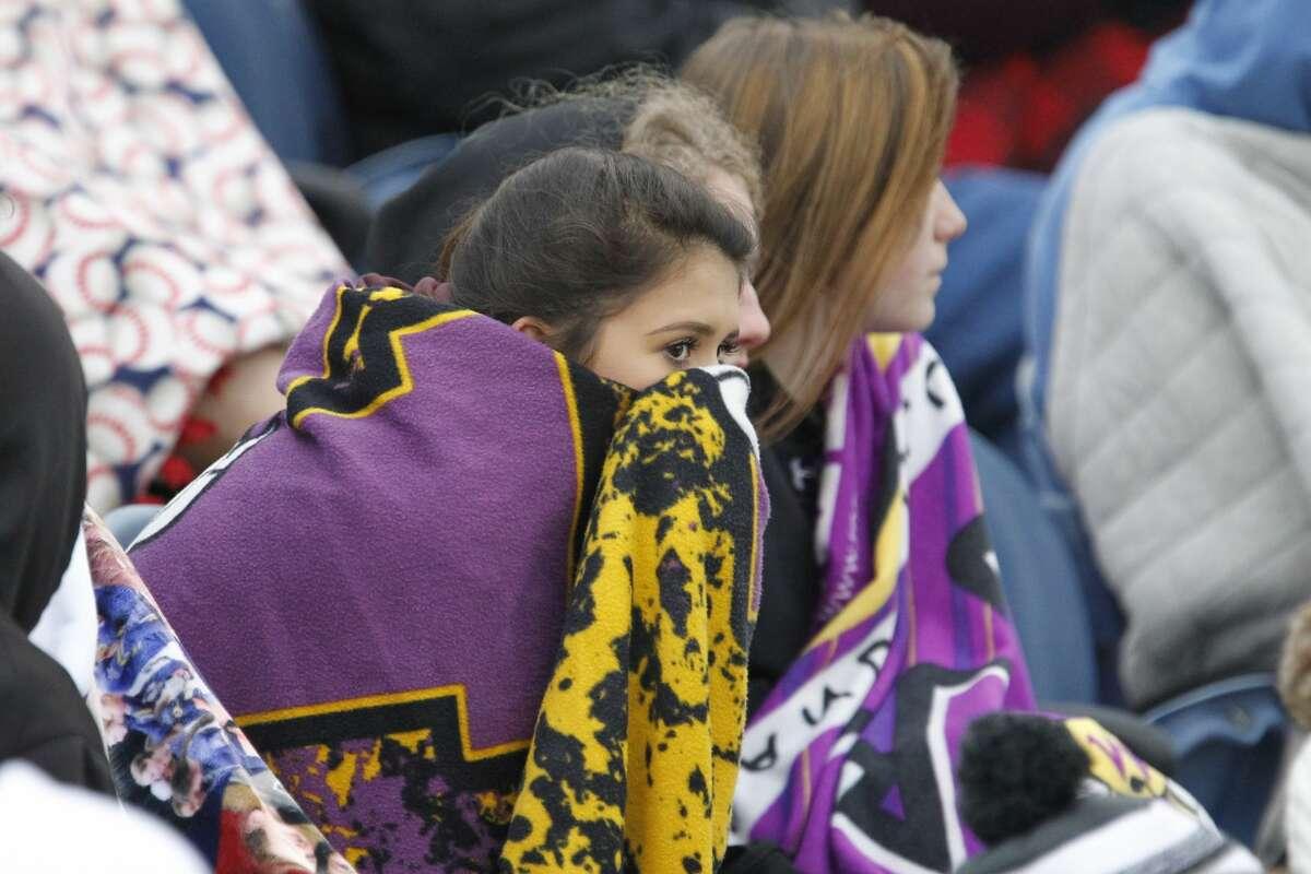 Midland High baseball fans bundle up while watching the game against Lee April 13, 2019, at Christensen Stadium. James Durbin / Reporter-Telegram