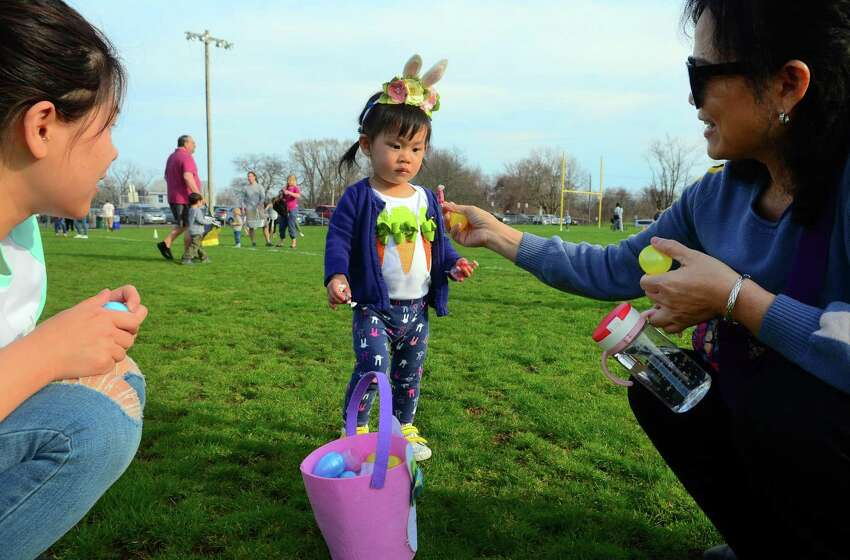 The Annual Children's Easter Egg Scramble at the South Pine Creek soccer field in Fairfield, Conn., on Saturday Apr. 13, 2019. New this year in addition to the scramble, there was a Family Fun Zone, music, food trucks, a bounce house & giant slide, an obstacle course sponsored by BOOST, arts & crafts sponsored by AR Workshop and much more. There was also an inaugural Adult Sundown Easter Egg Hunt with great raffle prizes.