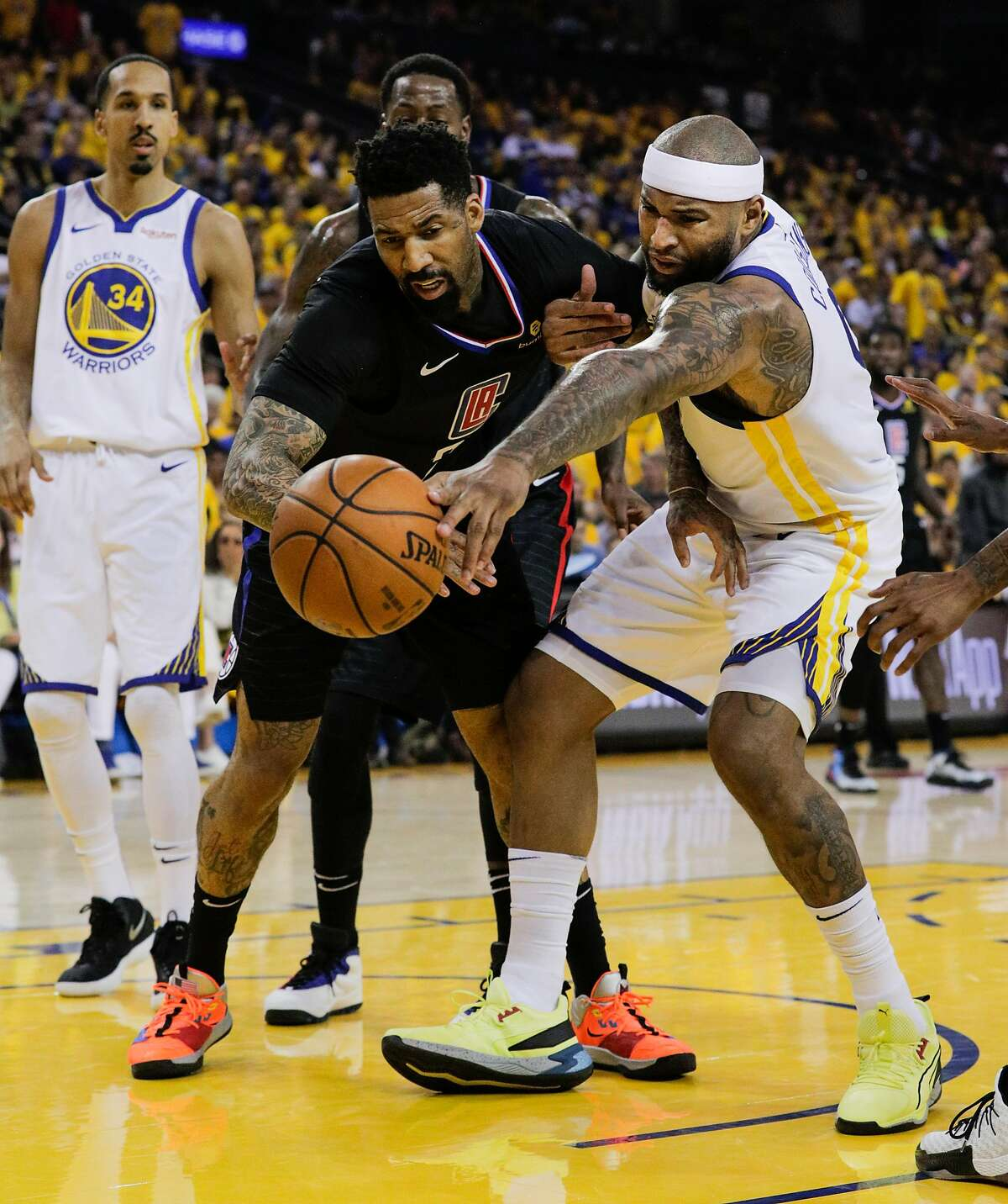 Golden State Warriors DeMarcus Cousins fights Los Angeles Clippers Wilson Chandler for a rebound in the second quarter during game 1 of the Western Conference Playoffs between the Golden State Warriors and the Los Angeles Clippers at Oracle Arena on Saturday, April 13, 2019 in Oakland, Calif.