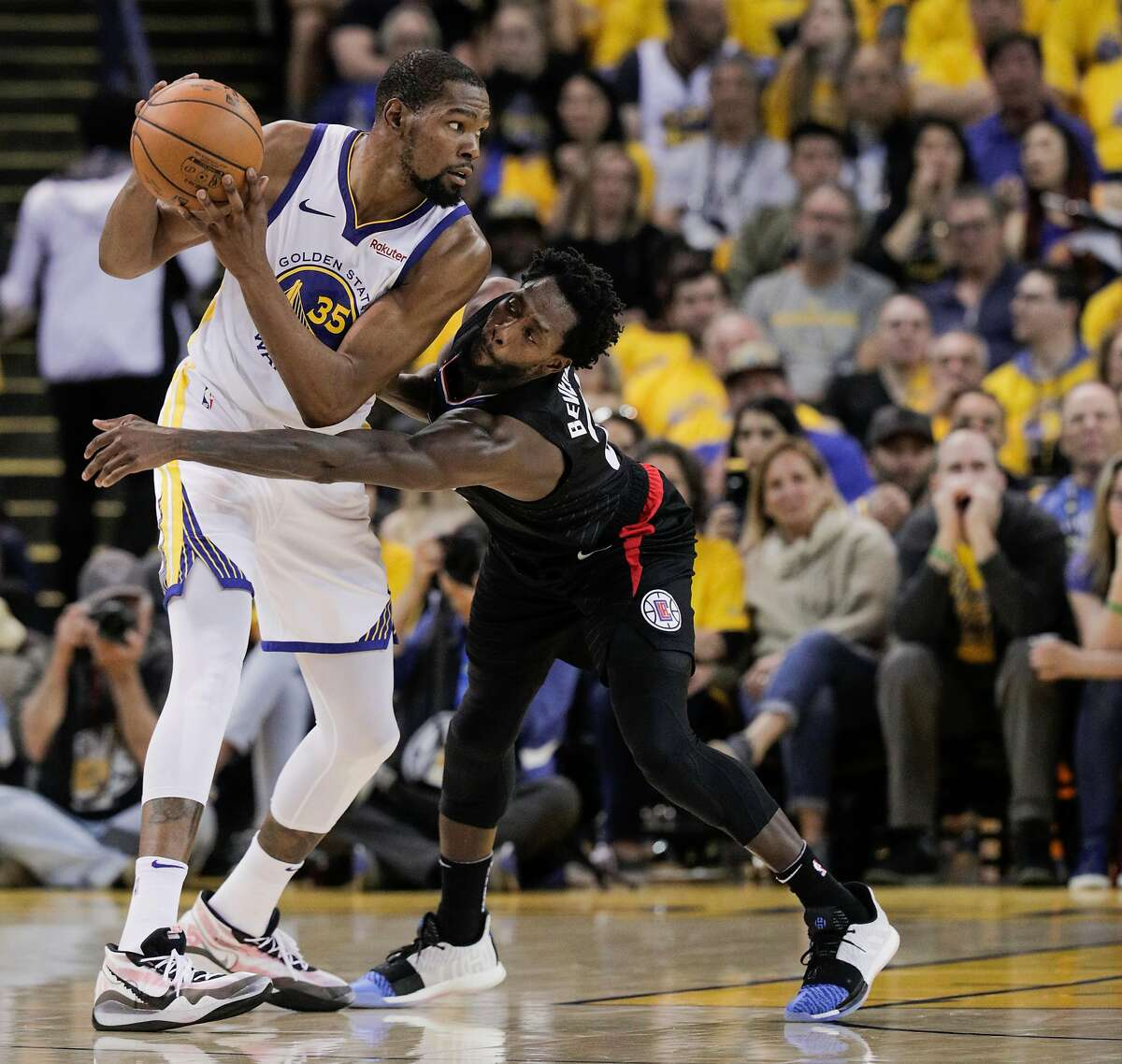 Los Angeles Clippers Patrick Beverley tries to defend against Golden State Warriors Kevin Durant in the third quarter during game 1 of the Western Conference Playoffs between the Golden State Warriors and the Los Angeles Clippers at Oracle Arena on Saturday, April 13, 2019 in Oakland, Calif.