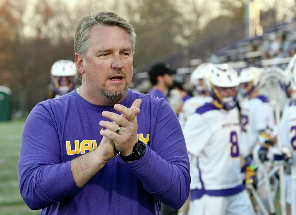 University at Albany head coach Scott Marr encourages his players before playing University of Maryland, Baltimore County's during a NCAA lacrosse game Saturday, April 13, 2019, in Albany, N.Y.