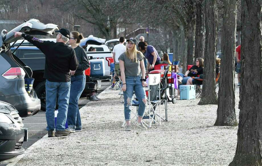 Fans tailgate before University at Albany plays University of Maryland, Baltimore County during a NCAA lacrosse game Saturday, April 13, 2019, in Albany, N.Y. Photo: Hans Pennink, Times Union / Hans Pennink