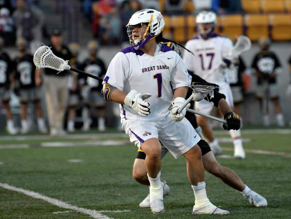 University at Albany's Tehoka Nanticoke (1) moves the ball against University of Maryland, Baltimore County during a NCAA lacrosse game Saturday, April 13, 2019, in Albany, N.Y.