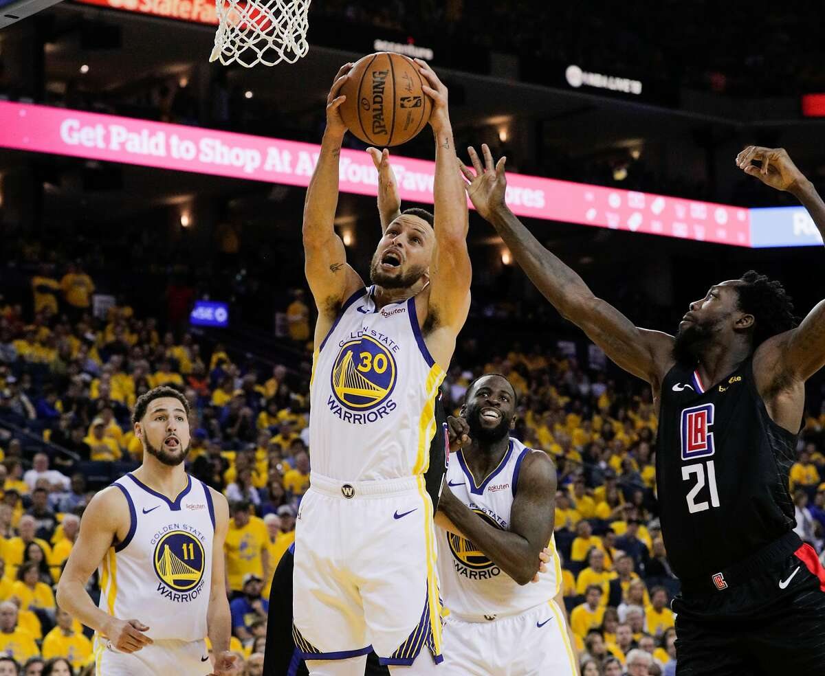 Golden State Warriors Stephen Curry goes up for a rebound over Los Angeles Clippers Patrick Beverley in the third quarter during game 1 of the Western Conference Playoffs between the Golden State Warriors and the Los Angeles Clippers at Oracle Arena on Saturday, April 13, 2019 in Oakland, Calif.