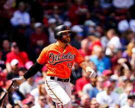 The Baltimore Orioles' Chris Davis hits a single in the first inning, snapping an 0-for-54 streak, against the Boston Red Sox at Fenway Park in Boston on Saturday, April 13, 2019. (Omar Rawlings/Getty Images/TNS) **FOR USE WITH THIS STORY ONLY**