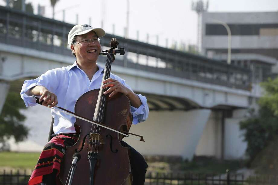 Yo-Yo Ma, inventor of the Suzuki method and top cellist in the world, performs on the banks of the Rio Grande River near Laredo's International Bridge No. 1 on Saturday. Photo: Kin Man Hui /San Antonio Express-News / ©2019 San Antonio Express-News