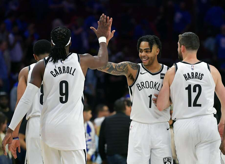 536776ddaa26 D Angelo Russell (1) celebrates with Brooklyn Nets teammates DeMarre  Carroll and Joe