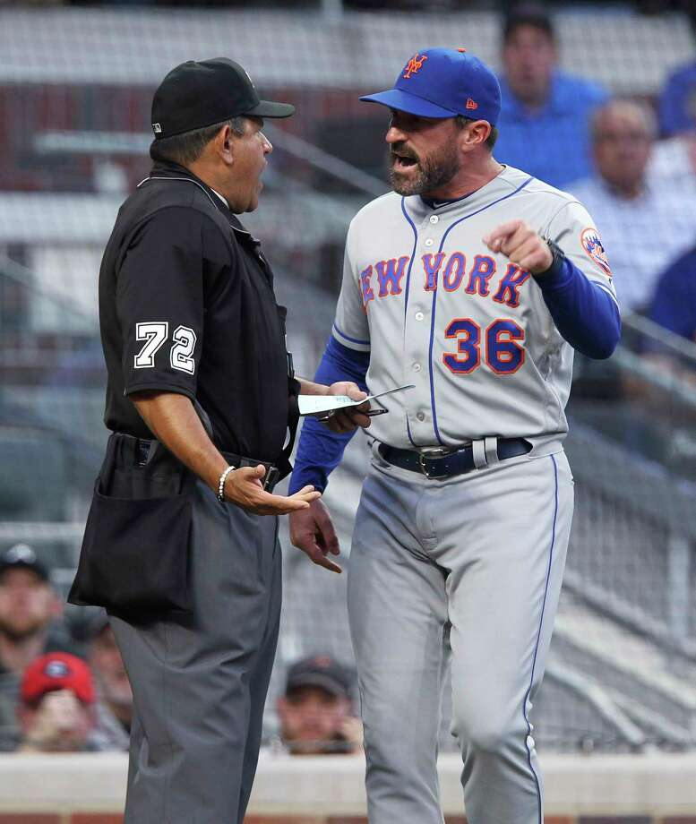 New York Mets manager Mickey Callaway, right, reacts after being ejected by home plate umpire Alfonso Marquez during the first inning of the team's baseball game against the Atlanta Braves on Saturday, April 13, 2019, in Atlanta. (AP Photo/Tami Chappell) Photo: Tami Chappell / Copyright 2019 The Associated Press. All rights reserved